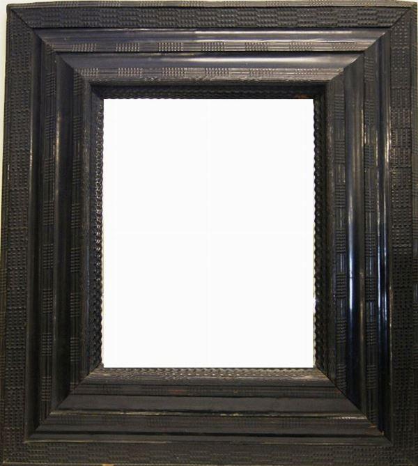 Specchiera, sec. XVIII, in cornice lignea guilloche, cm 88x100, specchio d'epoca posteriore