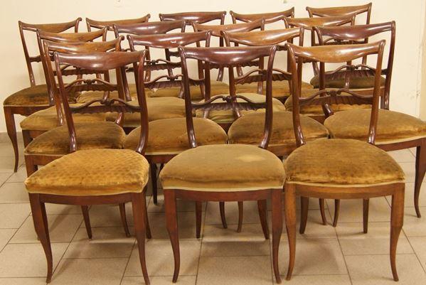 Sedici sedie, Italia settentrionale, sec. XIX, in noce,  imbottite e ricoperte in stoffa verde, difetti(16)