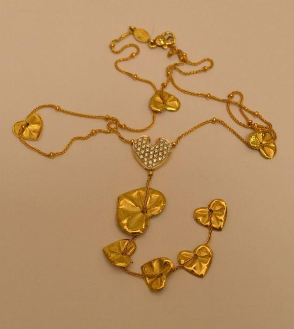 Collana in oro giallo, LEAF, con pendenti a forma di cuore e pavè di diamanti, g 15,7, diamanti ct. 0,48, marcata Torrini