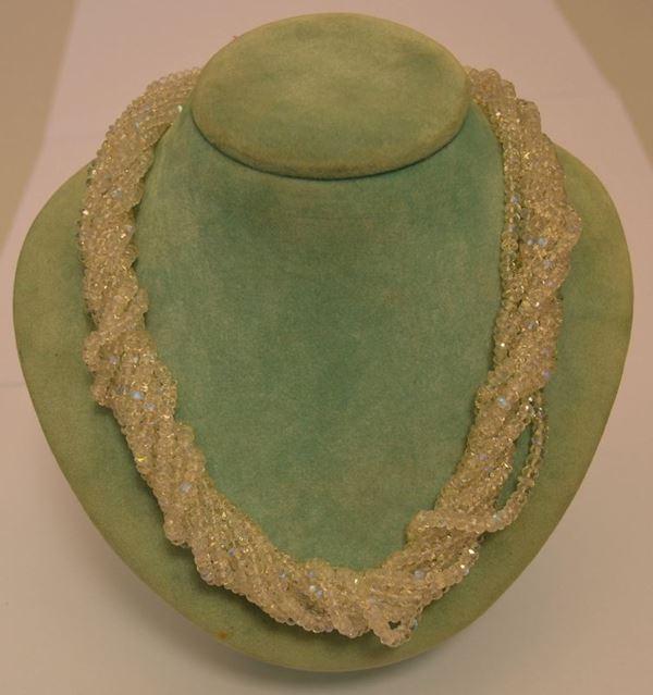 Collana a torchon, di nove fili di pietre dure sfaccettate, con fermature in oro bianco, peso oro g 7,6, marcato Torrini