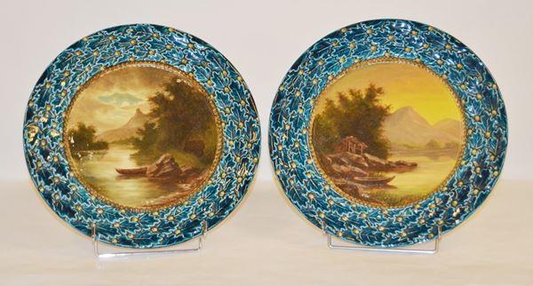 Coppia di piatti, Austria, sec. XX, in ceramica decorata con paesaggi montani, diam. cm 35