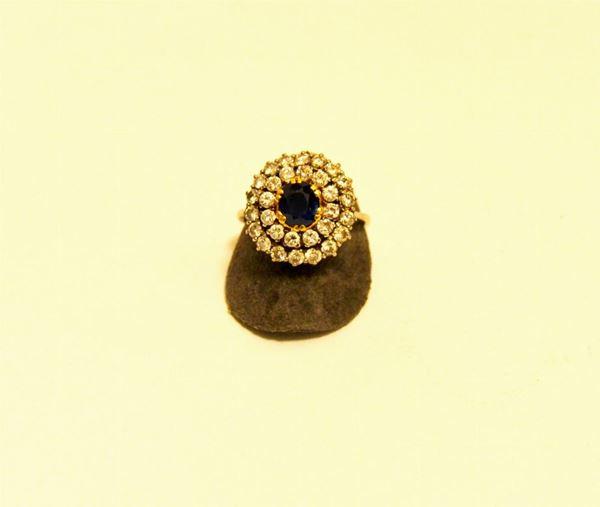 Anello in oro bianco con zaffiro ovale contornato da due cerchi di brillanti g 9