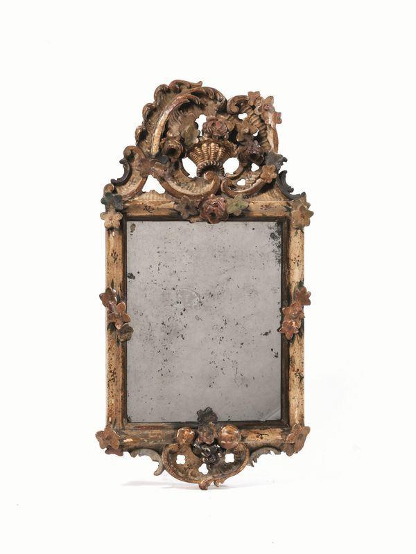 Specchierina, Veneto, seconda metà sec.  XVIII, in legno intagliato e laccato, sormontata da cimasa di gusto rocaille e decorata con fiori e frutta, cm 54x27