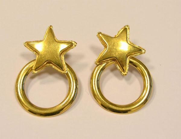 Paio di orecchini pendenti , in oro giallo