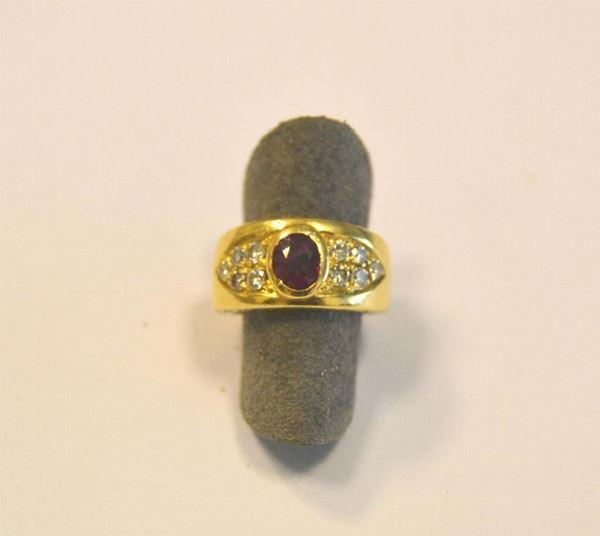 Anello in oro giallo, rubino e diamanti