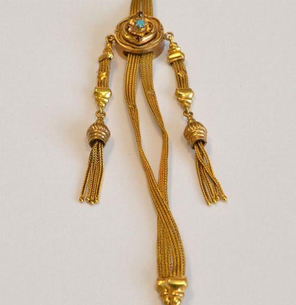 Lunga collana saliscendi , inizi sec.XX , in oro giallo 9KT