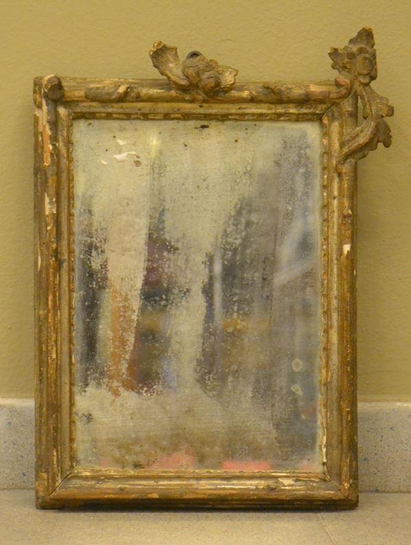 Cornice, sec. XVIII. in legno intagliato e laccato, cm 41x27