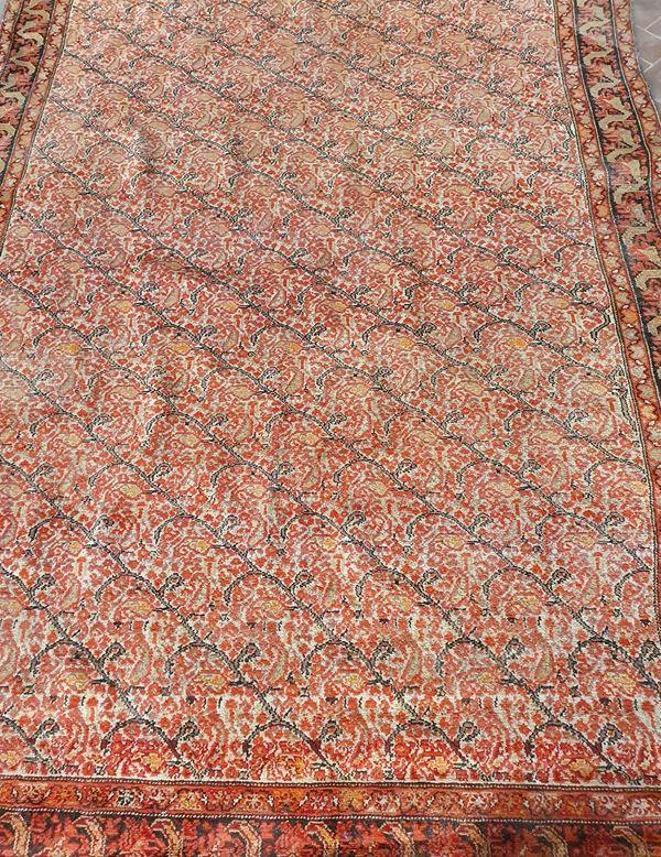Tappeto persiano, inizi sec. XX, fondo rosso a motivi floreali, cm 190x135,